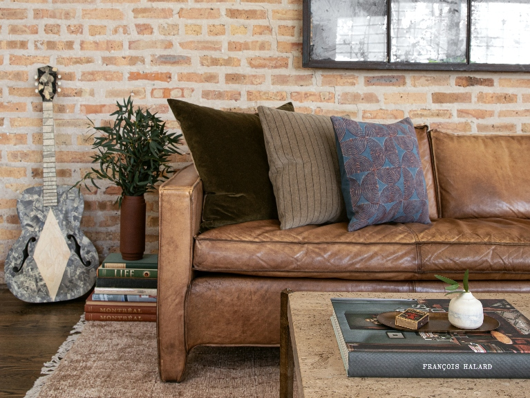 leather couch with throw pillows